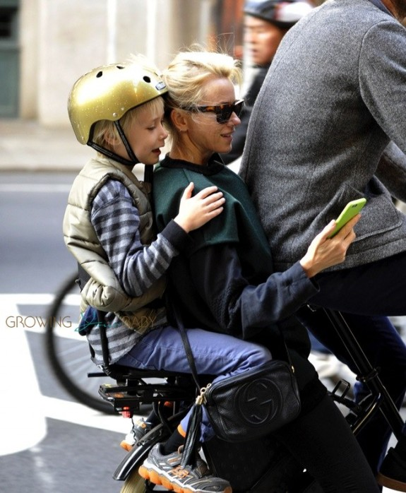 Naomi Watts on a bike with on Sasha and partner Liev Schreiber