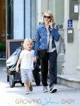 Samuel Kai lays on his mother, Naomi Watts, lap while she chats on her cell phone in NYC