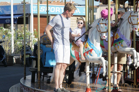 Neil Patrick Harris rides a carousel with son Gideon in St. Tropez