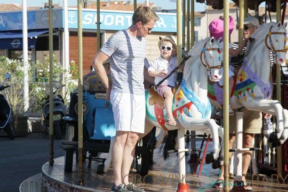 Neil Patrick Harris rides a carousel with son Gideon in St. Tropez