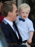 Adorable dad, Neil Patrick Harris, watches Harper Grace pull faces and even pulls a funny face back at Gideon Scott! LA