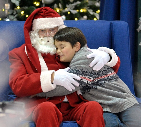 Nine-year-old Gabe Champage visits with Santa at Square One in Mississauga