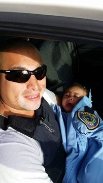 Officer Albert Pizana with baby Genesis