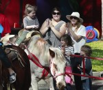 Olive Kopeman rides as horse at the market