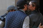Orlando Bloom and Miranda Kerr kiss after a walk with their son Flynn