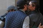 Orlando Bloom and Miranda Kerr kiss after a walk with their son Flynn