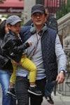 Orlando Bloom takes his son Flynn for a walk