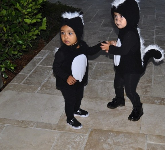 Penelope Disick and North West dressed as a skunks for Halloween