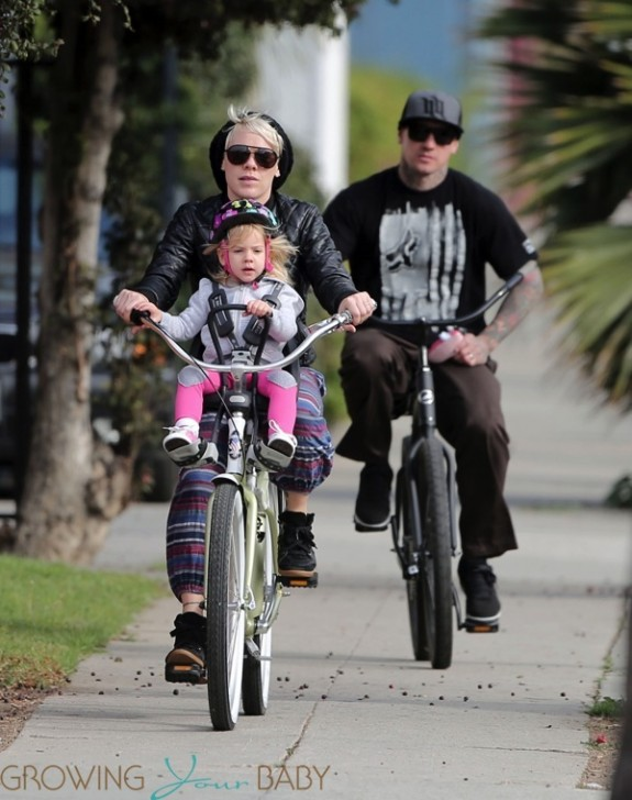 Pink, Carey Hart and their daughter Willow riding bikes in LA
