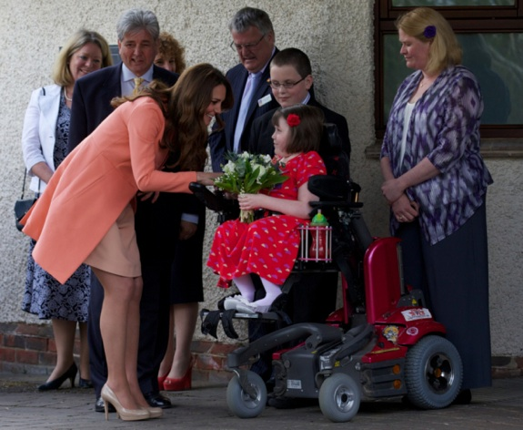 Pregnant Duchess of Cambridge receives flowers from Sally Evans at Naomi House