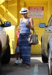 Halle Berry Shows Off Her Baby Bump In a Tight Maxi Dress While Out With Daughter Nahla