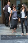 Halle Berry shows her baby bump as she heads to grab some lunch with a female companion in Los Angeles