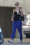 Jaime King shows off her growing baby bump in a black tank top as she makes a stop at a Coffee Bean in Los Angeles