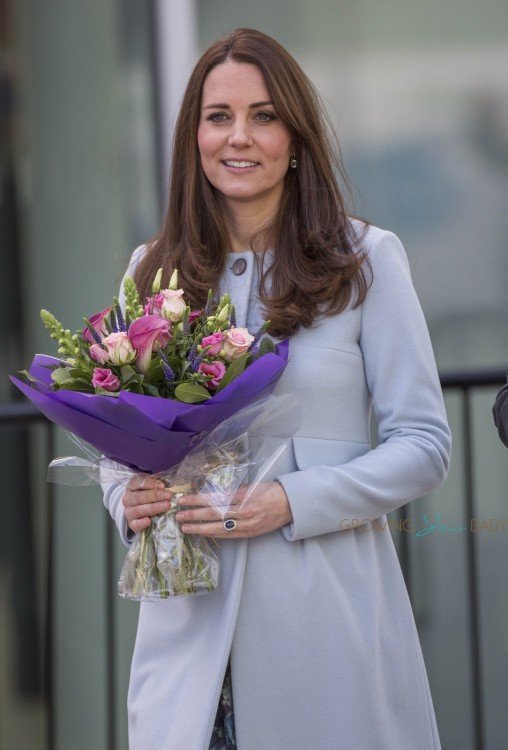 A pregnant Catherine, The Duchess of Cambridge, departs after visiting the Kensington Aldridge Academy in London