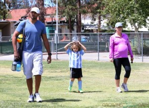 Pregnant Kendra Wilkinson and her husband Hank Baskett at their son's soccer game