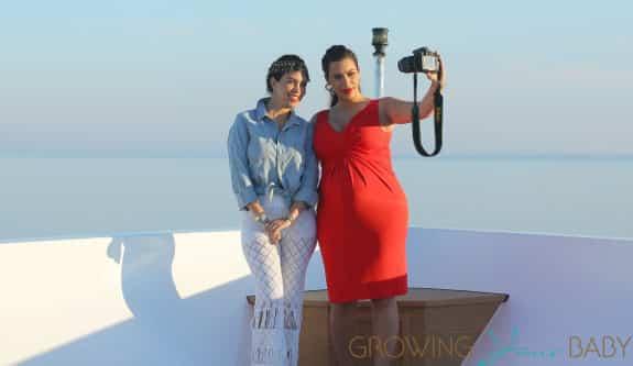 Kim Kardashian shows off her bump in tight red dress on board a yacht with Kourtney Kardashian in Greece