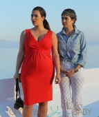 Kim Kardashian shows off her bump in tight red dress on board a yacht with Kourtney Kardashian in Greece