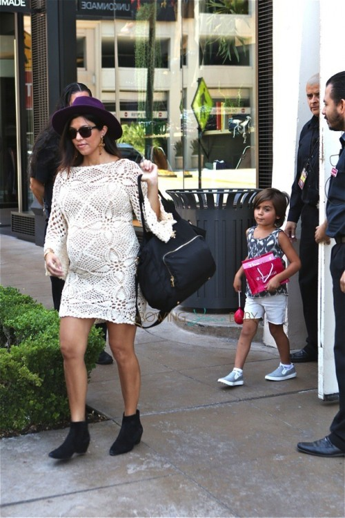 Pregnant Kourtney Kardashian and son Mason leave American Girl after a birthday party