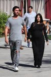 Pregnant Kourtney Kardashian at lunch with partner Scott Disick in LA