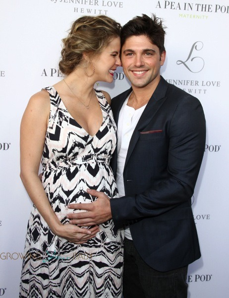 Pregnant Linsey Godfrey and Robert Adamson at the launch of Jennifer Love Hewitt maternity collection