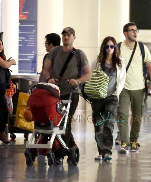 A pregnant Megan Fox shows off a slight baby bump at LAX