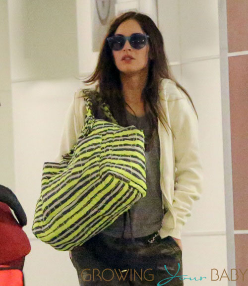 Megan Fox shows a little bit of her belly while in JFK airport with Brian Austin Green in NYC
