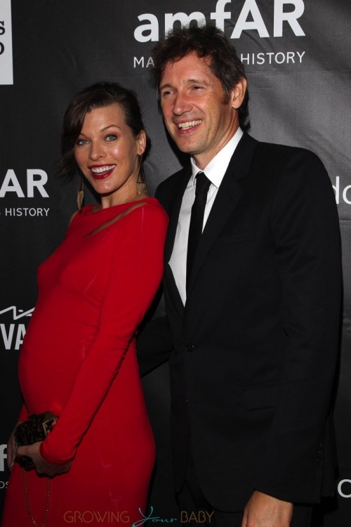 Pregnant Milla Jovovich and husband Paul WS Anderson at the amfAR LA Inspiration Gala Honoring Tom Ford