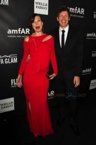 Pregnant Milla Jovovich and husband Paul WS Anderson at the amfAR LA Inspiration Gala Honoring Tom Ford