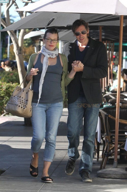 Milla Jovovich showing off a large baby bump in a tight tank top as she and her husband Paul W.S. Anderson walk back to their car after having lunch at La Scala in Beverly Hills