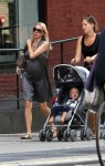 Pregnant Naomi Watts out for a stroll with son Alexander