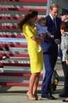 Prince William, Catherine and their son Prince George disembark at Sydney airport
