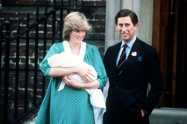 Princess Diana and Prince Charles outside of St. Mary's Hospital with Prince William
