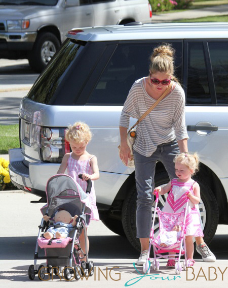 Eric Dane gets a visit from wife Rebecca Gayheart and their daughters Billie and Georgia, during a training session at a Los Angeles park