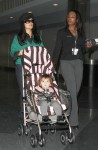Salma Hayek pushes her daughter Valentina in a Juicy Couture baby stroller through JFK airport in New York