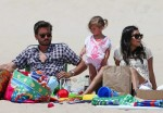 Scott Disick and Kourtney Kardashian at the beach with daughter Penelope