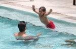 Kourtney Kardashian & Family Relaxing Poolside In Miami
