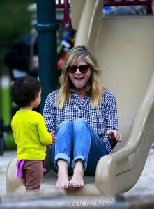 Selma Blair rides down the slide in LA