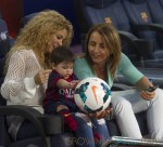 Shakira and baby son cheer on dad