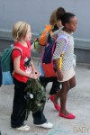 Angelina Jolie leads her kids Shiloh, Zahara, Pax, Knox and Vivienne out of the airport after arriving in Sydney