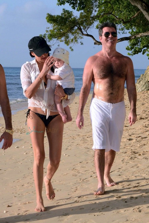 Simon Cowell & Lauren Silverman stroll on the beach in Barbados with son Eric