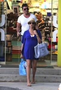 Simon Cowell & a very pregnant Lauren Silverman shop in Saint Barts