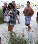 Simon Cowell and his girlfriend Lauren Silverman with baby Eric in Miami