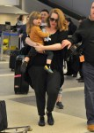 Singer Adele and her son Angelo Konecki arriving on a flight at LAX