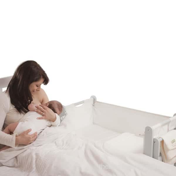 SnuzPod's 3 in 1 Bedside Crib - nursing mom