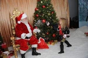 Stella McDermott throws snow at Santa