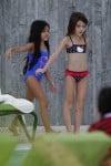 Suri Cruise dances poolside in Miami with a friend
