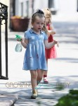 Twin daughters of Sarah Jessica Parker, Marion Broderick and Tabitha Broderick walk home from school with their nanny in the west village of New York City
