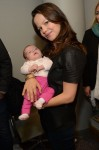 Tammin Sursok with daughter Phoenix at Secret Santa Workshop