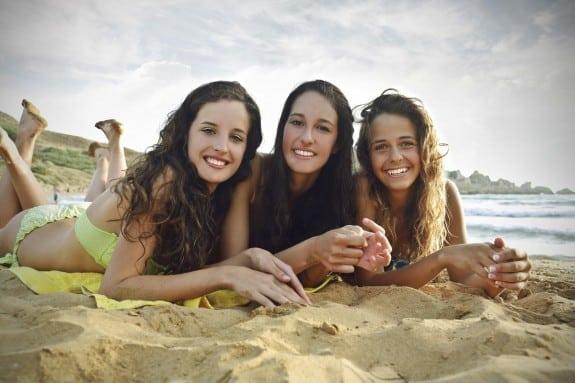 Teens Suntanning at the beach