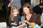 Tiffani Thiessen with her daughter at the Secret Santa Workshop